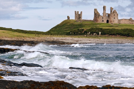 View of Dunstanburgh Castle at Craster Northumberland Stock Photo