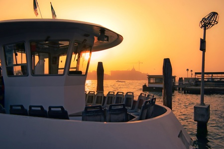 Water taxi moored closed for business at sunset in Venice Stock Photo - 8474312