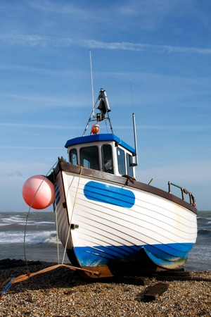 dungeness: Fishing boat on Dungeness beach Stock Photo