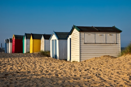 southwold: A row of brightly coloured beach huts in Southwold Suffolk Stock Photo