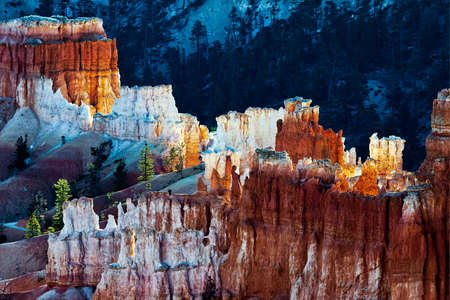 First rays of the sun striking Bryce Canyon photo