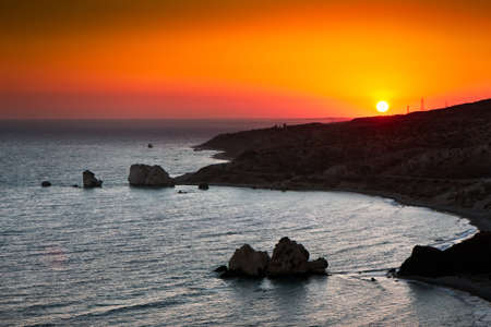 Sunset over Aphrodites rock photo