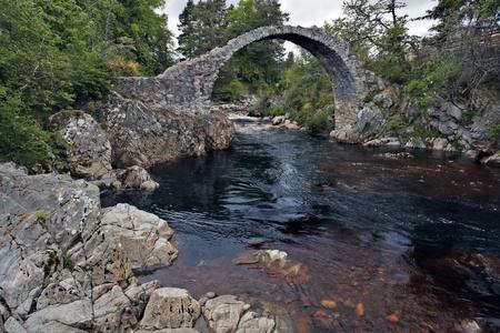 old packhorse bridge: Packhorse bridge at Carrbridge Stock Photo