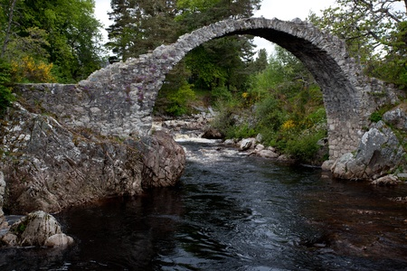 old packhorse bridge: Packhorse bridge at Carrbridge Stock Photo