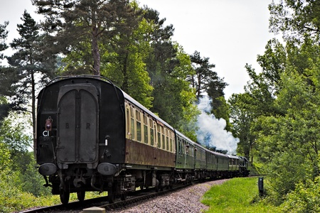 Rebuilt Bulleid Light Pacific No. 34059 steam locomotive near Kingscote Station photo