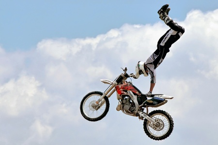 decorated bike: Stunt motorcyclist at the Hop Farm in Kent Editorial