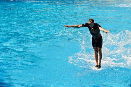 somersault: Man walking on water