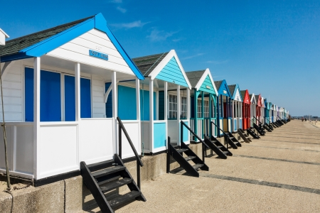 A row of brightly coloured beach huts in Southwold Suffolk 版權商用圖片