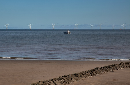 Wind turbines off shore at Colwyn Bay photo