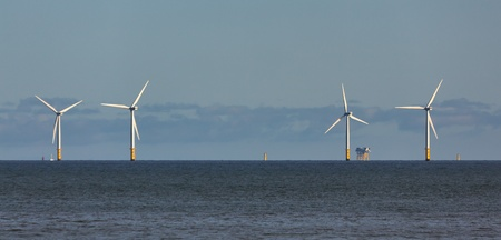 wind farm: Wind turbines off shore at Colwyn Bay Stock Photo