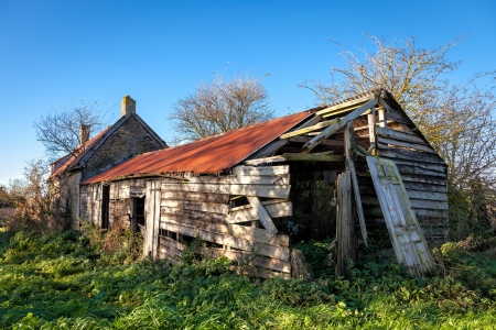 Derelict farmhouse and outbuildings in Cambridgeshire