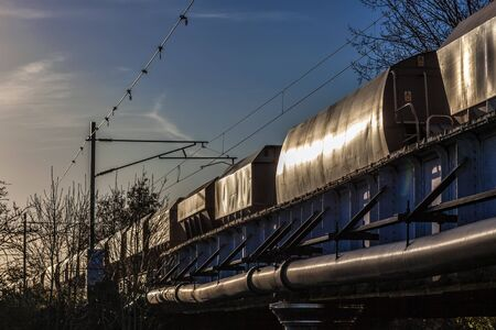 goods train: Goods train pulling out of Ely in the evening sunshine
