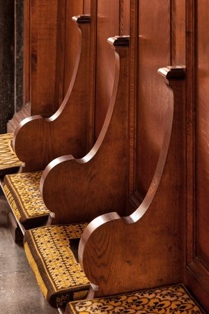 pews: Wooden seats and cushions in Ely Cathedral Editorial