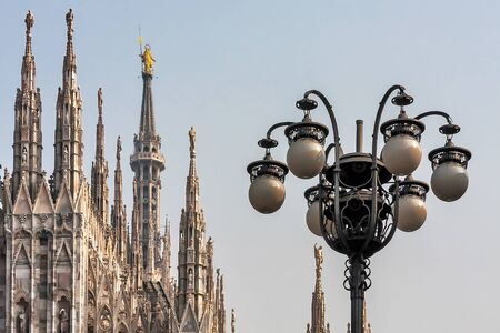 man made structure: Spires of the Duomo Cathedral and street lamps