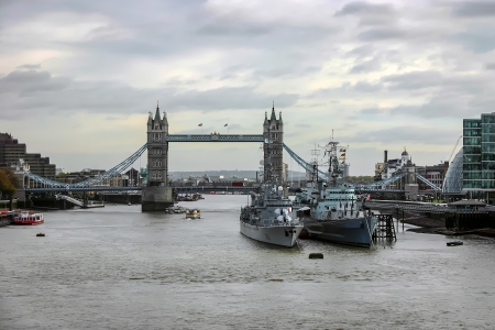 View of Tower Bridge and the pool of London with two warships photo