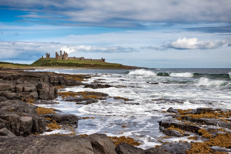 View of Dunstanburgh Castle at Craster Northumberland photo