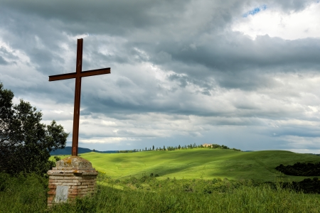 val d orcia: Rusty iron cross in Val d Orcia