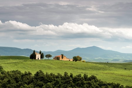 Small church on the crest of a hill in Val d Orcia