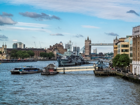 anchored: HMS Belfast anchored near Tower Bridge Stock Photo
