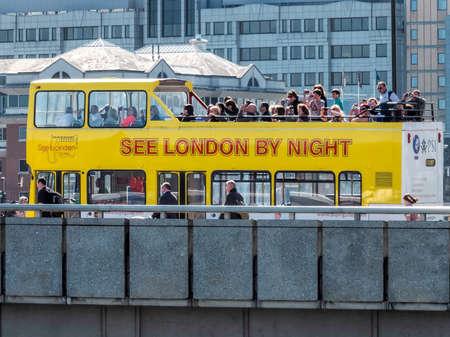 take a history: Tourist bus on London Bridge Editorial