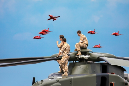 Helicopter crew watching the Red Arrows display