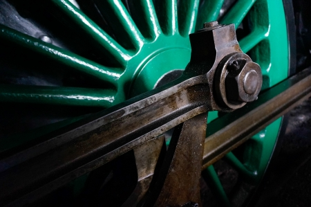 grease paint: An old steam train wheel