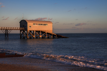 lifeboat station: Sunset at Selsey Bill Stock Photo