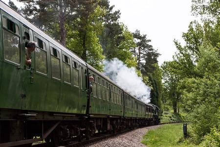 Rebuilt Bulleid Light Pacific No. 34059 steam locomotive near Kingscote Station photo