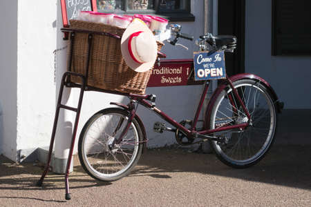 sweet shop: PENARTH WALES UK MARCH 2014 - View of an old tradesman bicycle outside a sweet shop in Penarth