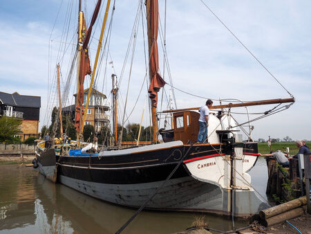 furled: FAVERSHAM, KENTUK - MARCH 29 : Close up view of the Cambria restored Thames sailing barge in Faversham Kent on March 29, 2014. Unidentified people