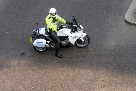 Metropoliatan Police traffic officer clearing the way for a VIP