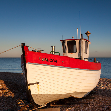beached: Fishing boat on Dungeness beach Editorial