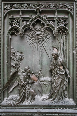 jesus rose: Detail of the main door at the Duomo Cathedral in Milan Stock Photo