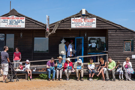 People enjoying fish chips in Southwold