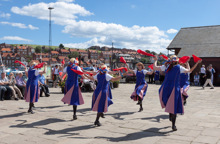 mixed age range: Women Morris dancing in Whitby