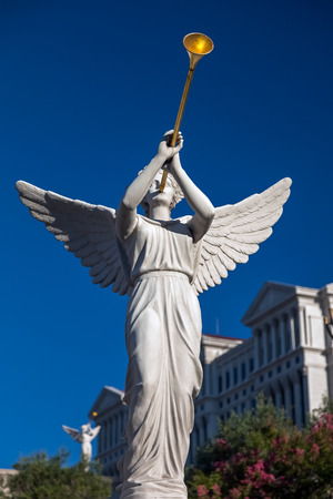Angel playing golden bugle photo