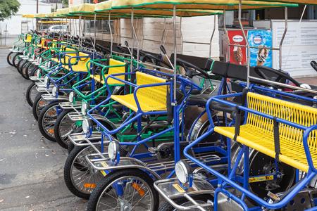 Row of four wheeled bikes in Santa Barbara