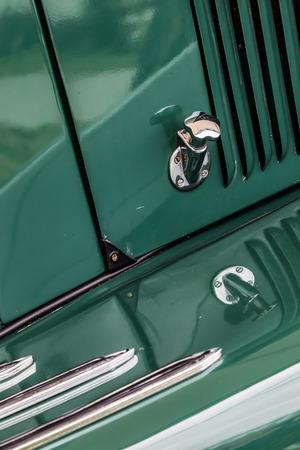 release: Close-up of a bonnet release on an old Jaguar car Stock Photo