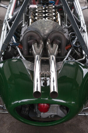 carburettor: Twin chrome plated exhausts of a vintage racing car