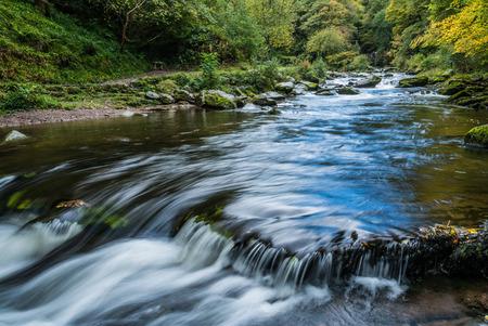 watersmeet: Bridge over the East Lyn River near Lynmouth in Devon on