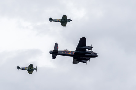 Avro Lancaster flanked by two Spitfires