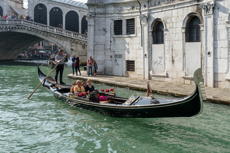 ferrying: Gondoliers ferrying people in Venice Editorial