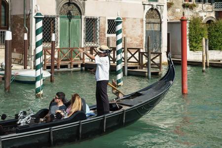 gondolier: Gondolier ferrying people in Venice