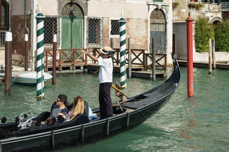 ferrying: Gondolier ferrying people in Venice