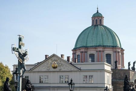 vermeil: Statuary of St Cross - Calvary on Charles Bridge in Prague Editorial