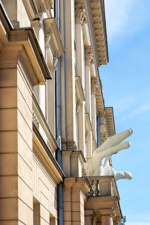 aleksander: Large white hand attached to The Aleksander Zelwerowicz Theatre Academy in Warsaw