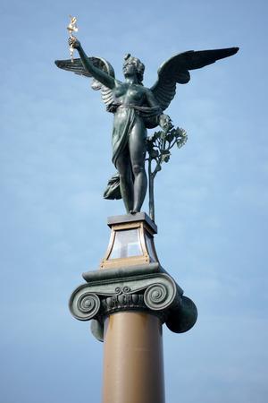 czech women: Angel on top of a column on the Cechuv Most Bridge in Prague