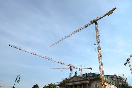 multitude: Multitude of cranes above St. Hedwigs Cathedral in Berlin