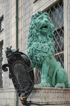 window seal: Statue of  a green Lion at Odeonsplatz in Munich