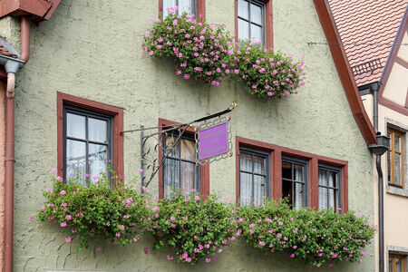 flower baskets: Flower baskets beneath windows in Rothenburg